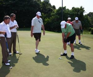 Photo Blind Golfers on green putting IBGA Constitution
